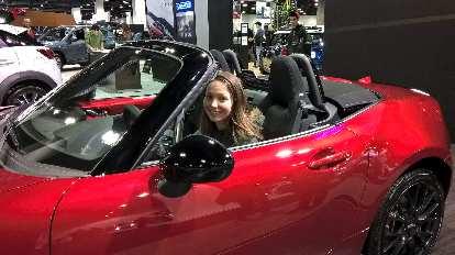 Maureen in the red 2016 Mazda MX-5/Miata.