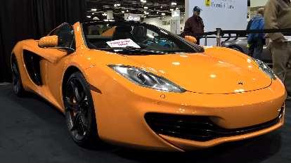 Orange McLaren MP4-12C spider, maybe a 2014 model.