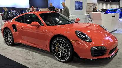 Orange 2016 Porsche 911 Turbo.