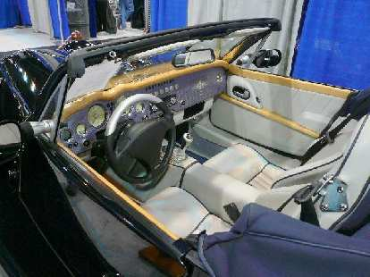 The interior of the Morgan Aero 8 is a mix of contemporary and classic styling, but the plain-front, garish steering wheel looked very out of place.