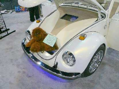 A monkey in the trunk of a pimped-out old VW Beetle.