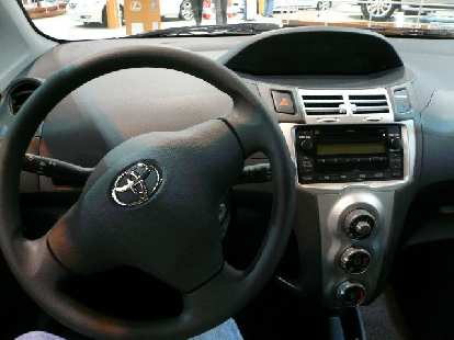 Toyota Yaris is an entry-level car, and the interior really underscores this.  Lots of hard plastics and cheap-looking.