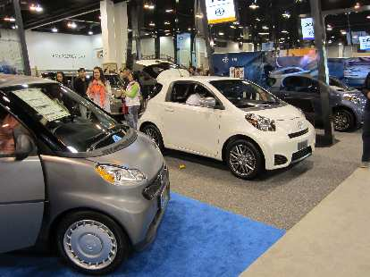 "A Smart ""pure coupe"" (left) and two Scion IQs (center and right)."
