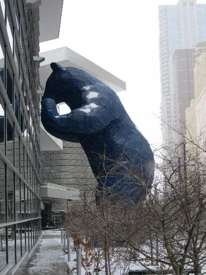 The Blue Bear peaking into the Denver Convention Center to look at cars.