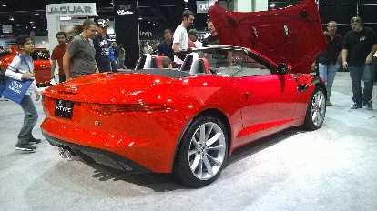 Red Jaguar F-Type convertible.