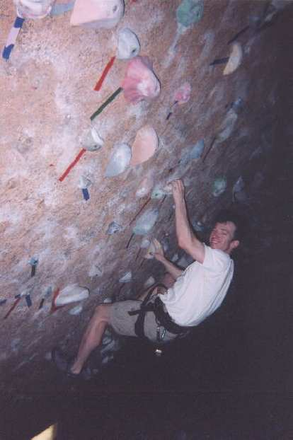[Denver] After arriving in Denver, I got to do some indoor rock climbing with my friend Ken at the Rock 'n Jam gym.  Here's Ken showing how it's done in the boulder cave.