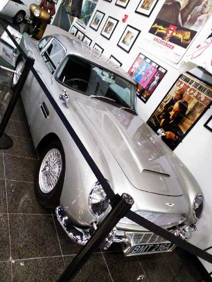 The classic James Bond Aston Martin DB5.  You can see the rear tire slicer, machine guns poking out the front and extending overriders.