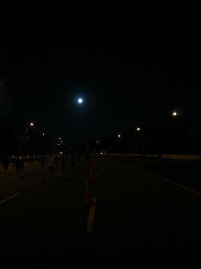 [Mile 4, 6:32 a.m.] A full moon lit up Epcot Center Dr.