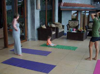 Doing yoga with Charis, little Zoe, and our super fit yoga instructor Kelly.