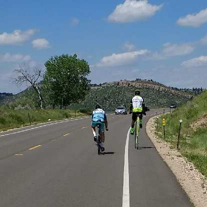 Near the Horsetooth Reservoir, someone was riding a fluorescent green penny farthing as part of the MS 150 ride.
