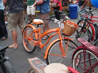 Orange cruiser with basket.