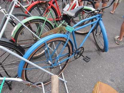 """Blue cruiser with """"1MOBKE"""" license plate."""