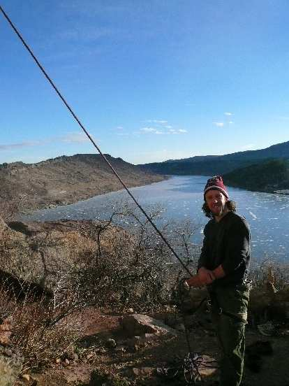 Nick belaying, with a great view of the Horsetooth Reservoir behind him.