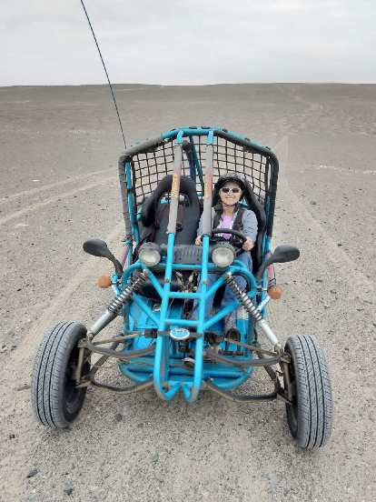 Mel and the dune buggy we rented in Paracas.