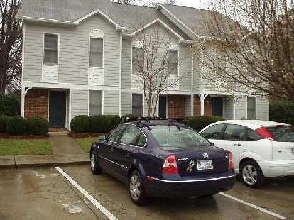 dark blue Volkswagen Passat, white Ford Focus 5-door hatchback, townhomes, Durham, North Carolina