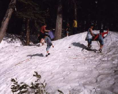 People playing in the snow off Highway 120.