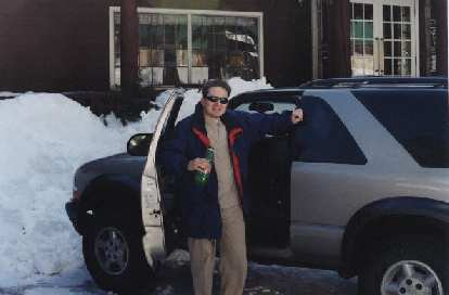 Brent and his Chevy Blazer in front of the Strawberry Inn.