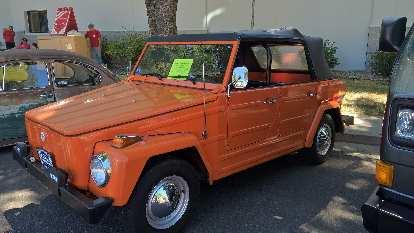 An orange 1974 VW Thing.
