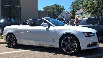 A white 2012 Audi A5 Convertible.