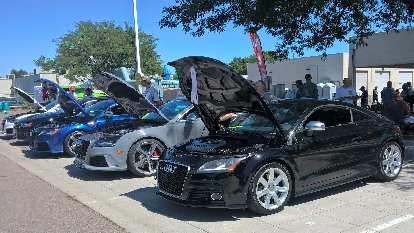A black 2009 Audi TTS coupe.