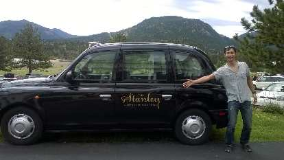 Felix Wong with the Stanley Hotel London Taxi (black TX4 Hackney Carriage).