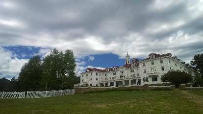 Stanley hotel with clouds above.