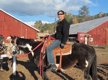 Felix Wong on a horse.