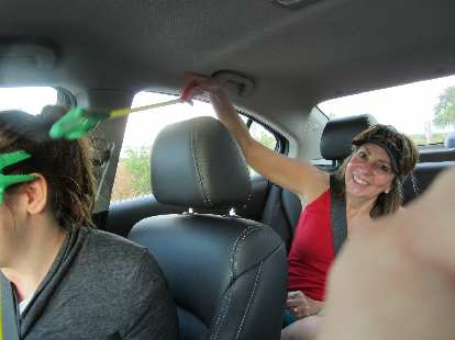 Kelly and her mom going at it with their alligator toys while I drove.