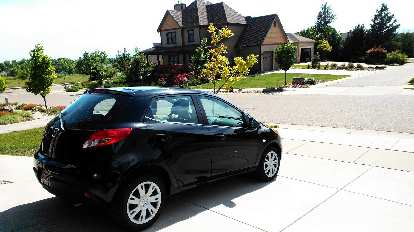 The Mazda 2 rental car was a sporty, gas-saving car to transport my bike to the ride.