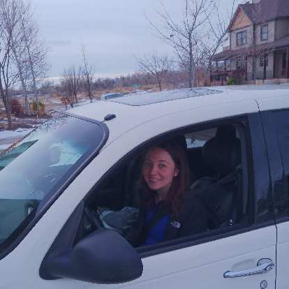 Maureen in her new car!