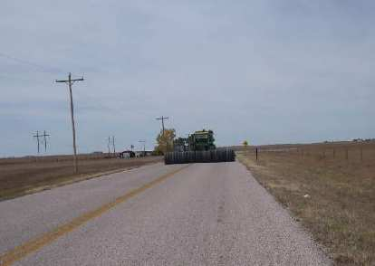 [Mile 107] Not much traffic along the frontage road by I-80, but there was this tractor that was hogging up the whole road.  Fortunately, we were going the same direction.