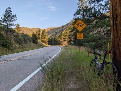 """Poudre Canyon, yellow signs of bicycle and """"share the road"""""""