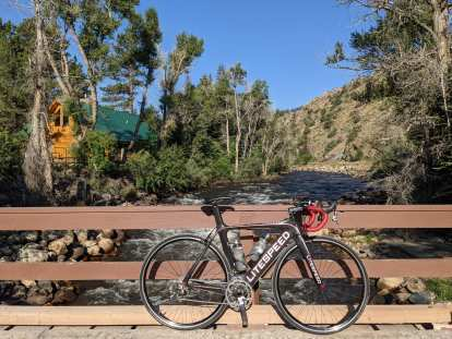 My black Litespeed Archon C2 in front of the Poudre River.