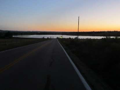 [Mile 3] Sunrise beyond the Kluver Reservoir.