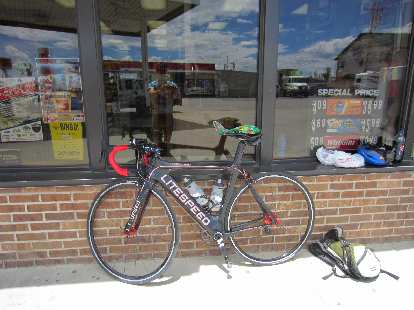 [Mile 100.4] At a convenience store in Walden, I ate a microwaved burrito---my traditional Walden meal.  The burrito is on the Super Bike's saddle.