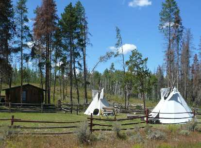 [Mile 86, 12:23 p.m.] Teepees around Gould, CO.