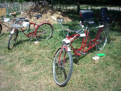 """A 1958 Schwinn Tiger with rare aluminum 3-speed hub, and a 1960s Western Flyer Tandem sold by Western Auto with an unoriginal """"tank"""" from a Western Flyer Sonic Flyer."""