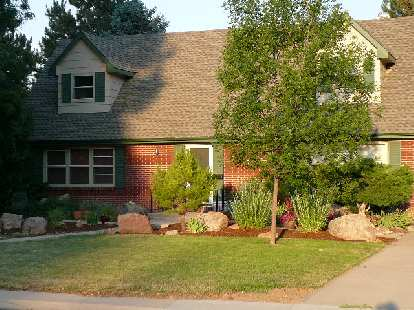 Well-done with a mixture of large rock, brush and mulch... looks pretty low-maintenance to me.