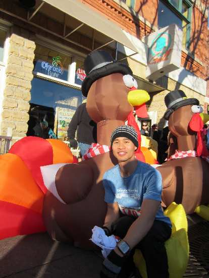 Felix Wong with the traditional blowup turkeys.