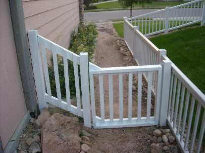 """An """"after"""" shot of the rear of the side gate and fence."""