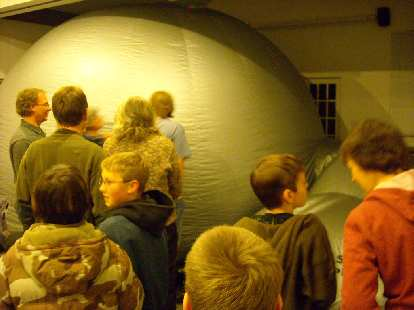 """At """"Legnds of the Stars"""" at the Discovery Science Center's Star Lab Planetarium, we crawled into these puffy """"tents"""" to learn about constellations."""