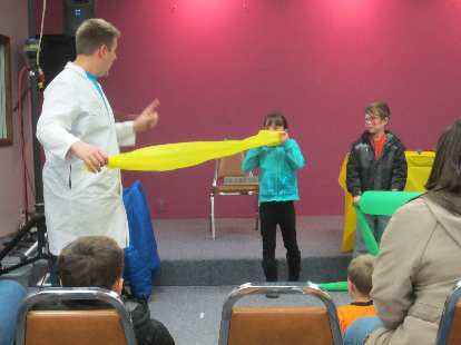 Some kids getting a lesson on the Bernoulli principle at the Science Matters Show.