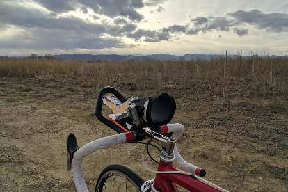 Flat Stanley during a bicycle ride, with the Front Range of Colorado in the background.