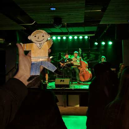 Flat Stanley listening to live music inside The Artery.