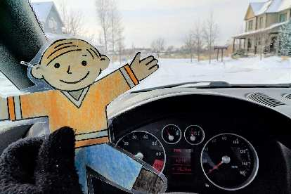 Flat Stanley behind the wheel on snow-covered roads in Fort Collins.