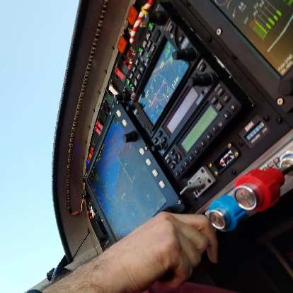 Easing out the throttle of the Van's RV-14A homebuilt plane.