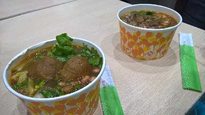 Paper bowls of meatball soup served up in a small restaurant off the Shangxiajiu Pedestrian Street in Guangzhou, China.