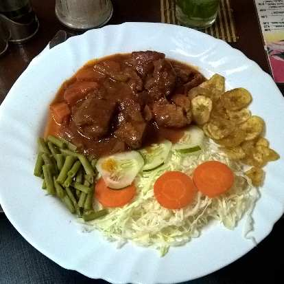 Fricasé de cerdo (stewed pork) with green beans, cabbage, carrots and plantains at Don Saluatore restaurant in Havana Vieja.