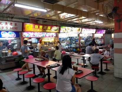 At the Chinatown Market in Singapore, there were hundreds of food stalls with good, cheap food.