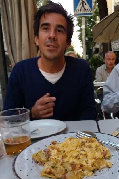 My friend Javi with huesos rotos (broken eggs) in Madrid.